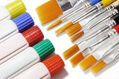 Tubes of color paints and brushes Stock Photo