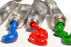 Tubes with colorful paints. Red, green and blue Royalty Free Stock Photo