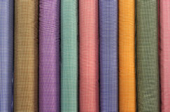 Tubes of Colorful Square Patterned Fabrics Royalty Free Stock Photography