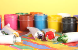 Tubes with colorful watercolor and jars Royalty Free Stock Photo