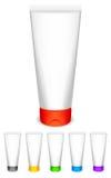 Tubes crèmes avec des chapeaux de couleur. Image stock