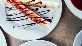 Tubes with cream filling and other dishes on the table. In the restaurant royalty free stock image