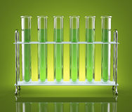Tubes with green chemicals. Test tubes with blue color reagents are ranked frontally Royalty Free Stock Photo