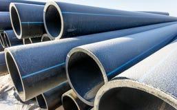 Tubes High Density Polyethylene. Pipes of high-density polyethylene for the construction of pipelines stock photo