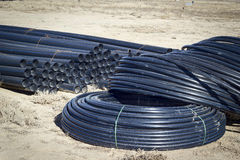 Tubes High Density Polyethylene. Plastic pipes are used for construction and repair of pipelines transporting water for household, drinking hot and cold water Royalty Free Stock Photography