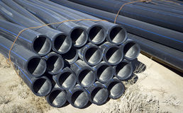Tubes High Density Polyethylene. Plastic pipes are used for construction and repair of pipelines transporting water for household, drinking hot and cold water Stock Photography