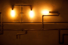 Tubes and lamps on the wall. Royalty Free Stock Images