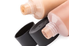 Tubes with make up liquid foundation Stock Images