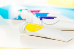 Tubes of multicolored oil paint with copy-space Stock Photography