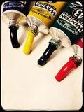 Tubes of oil paints. Oil paints squeezed from tubes Royalty Free Stock Photo