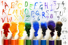 Tubes of paint with alphabet Royalty Free Stock Photos