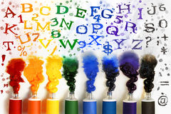 Tubes of paint with alphabet Royalty Free Stock Photo