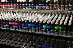 Tubes of professional tattoo paint at showcase Stock Photography