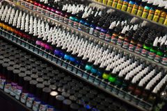 Tubes of professional tattoo paint at showcase Royalty Free Stock Images