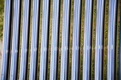 Tubes of a solar heating system as a background. Elements of solar heating system. Details of evacuated tube solar collector royalty free stock image