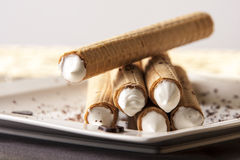Tubes with whipped cream Stock Image
