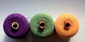 Tubes of thread. Three tangle of thread purple, green and orange on a white background Stock Photography