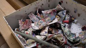 Tubes of used oil paint are in the box. Old tubes of oil paint. 4K.  stock video