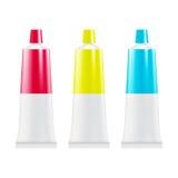 Tubes vides de pâte dentifrice ou de crème moquerie de paquet  Photographie stock libre de droits