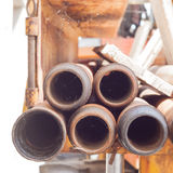 Tubi del metallo con le ragnatele Fotografia Stock