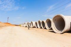 Tubi della caditoia della strada della costruzione Immagini Stock Libere da Diritti