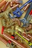 Tubi e montaggi del ` s dell'idraulico Fotografie Stock Libere da Diritti