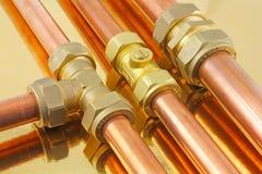 Tubi e montaggi del ` s dell'idraulico Fotografie Stock