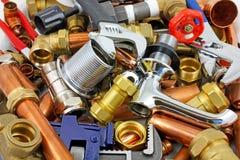 Tubi e montaggi del ` s dell'idraulico Fotografia Stock Libera da Diritti