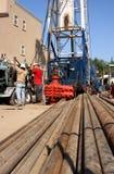 Tubi e pozzo di petrolio Fotografia Stock