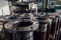 Tubi finiti della flangia in fabbrica immagine stock libera da diritti