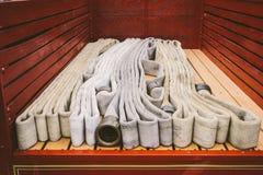Tubi flessibili d'annata di estinzione di incendio Immagini Stock