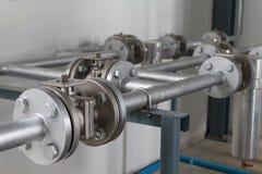 Tubi flessibili e valvole di alta pressione Immagini Stock