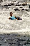 Tubing. Woman tubing on a river Stock Image