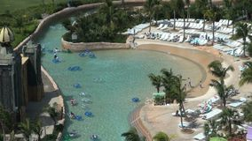 Tubing down lazy river aerial view stock footage