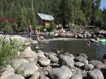 Tubing down the san juan river in the summertime. People drifting on the water as seen in pagosa springs, colorado stock video footage