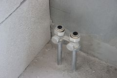 Tubing heat exchanger flat. two pipes protrude from the floor during repairs to the wall. the replacement of the batteries, off stock photos