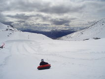 Tubing from the mountain Royalty Free Stock Photo