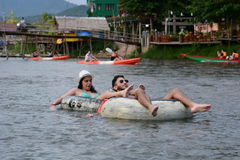 Tubing on Nam Song river. Vang Vieng. Laos. Vang Vieng is a tourist-oriented town in Laos in Vientiane Province about four hours bus ride north of the capital royalty free stock photography
