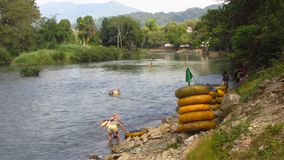 Tubing on the Nam Song River in Vang Vieng. Laos stock video footage