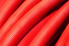 Tubing. Red plumbing pipe close-up. Royalty Free Stock Photography