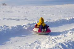 Tubing riding, winter recreation and sport. stock images