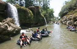Tubing. Travelers enjoy a trip on the river water Oyo, in Gunungkidul, Indonesia Stock Image