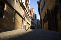 TUBINGEN/GERMANY-JULY 29 2018: A Muslim traveler woman using sunglasses, walking on the sidewalks of the city of Tubingen which royalty free stock photography