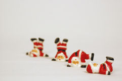 Tubling Santa. Four santa figures working out against a light grey background stock images