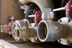 Tubo de agua en el coche de bomberos Imágenes de archivo libres de regalías