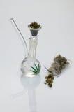 Tubo de cristal con marijuana Imágenes de archivo libres de regalías