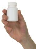 Tubo de ensaio com uma droga em uma mão Fotografia de Stock Royalty Free