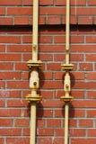 Tubo de gas en la pared Imagen de archivo libre de regalías