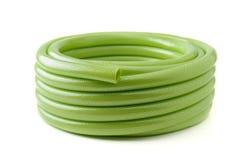 Tubo de goma verde Imágenes de archivo libres de regalías