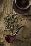 Tubo de tabaco con café Fotos de archivo